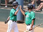 SIOUX FALLS, SD - AUGUST 18:  Brian McGuire #4 from the Renner Monarchs gets a high five from teammate Jason Nyhus #21 after scoring against the Sioux Falls Brewers during the third inning Sunday afternoon during the Class A Amateur Baseball Tournament at the Sioux Falls Stadium. (Photo by Dave Eggen/Inertia)