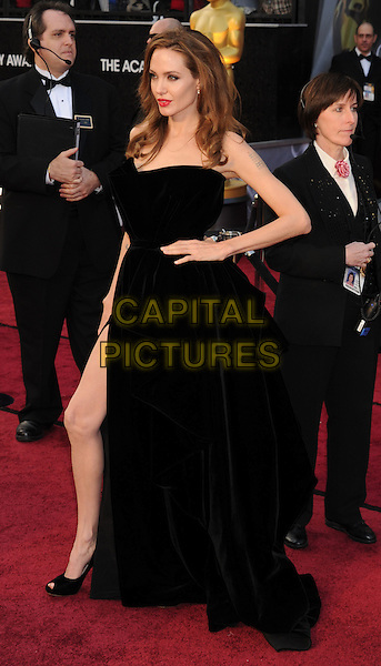 Angelina Jolie.Arrivals to the 84th Annual Academy Awards held at The Theatre at Hollywood & Highland Centre in Hollywood, California, USA. .February 26th, 2012.oscars full length dress black strapless  hand on hip slit split .CAP/ROT/TM.©Tony Michaels/Roth Stock/Capital Pictures