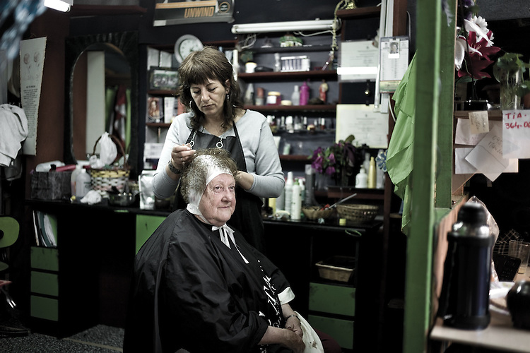 Images from the Peñarol neighborhood, Montevideo, Uruguay.  ..In a very 'old fashioned way', next to the bar is this multipurpose store that serves as a hairdressing saloon, market and mini-slot machine recreation center.  Peñarol neighborhood, Montevideo, Uruguay.