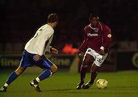 06/12/2003 - Photo  Peter Spurrier.FA Cup 2nd Rd - Northampton v Weston S Mare.Nothamptons Des Lyttle, takes the ball round the side of Westons Marc MacGregor.