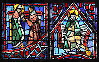 Fulbert with the monk Odilo of Cluny (left) indicating his close links with the monastic world, and St Gilles with his deer in front of a musical score (right), representing the many liturgical songs which Fulbert wrote, from the Life of Fulbert stained glass window, in the south transept of Chartres Cathedral, Eure-et-Loir, France. This window replaces the original 13th century window depicting the Life of St Blaise, which was destroyed in 1791. It was created in 1954 by Francois Lorin as a gift of the Institute of American Architects, on a theme chosen by the Canon Yves Delaporte. It depicts the life of Fulbert, bishop of Chartres in the 11th century. Chartres cathedral was built 1194-1250 and is a fine example of Gothic architecture. Most of its windows date from 1205-40 although a few earlier 12th century examples are also intact. It was declared a UNESCO World Heritage Site in 1979. Picture by Manuel Cohen