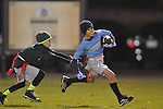 The Panthers' Braden Prescott eludes the Eagles' Philip Neilson in Oxford Park Commission flag football, at FNC Park in Oxford, Miss. on Tuesday, November 19, 2013.