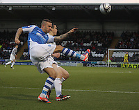 Rowan Vine clears under pressure from John McGinn in the St Mirren v St Johnstone Clydesdale Bank Scottish Premier League match played at St Mirren Park, Paisley on 8.12.12.