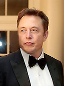 Elon Musk, co-founder and chief executive officer of Tesla Motors Inc.  arrives to a state dinner hosted by U.S. President Barack Obama and U.S. First Lady Michelle Obama in honor of French President Francois Hollande at the White House in Washington, D.C., U.S., on Tuesday, Feb. 11, 2014. Obama and Hollande said the U.S. and France are embarking on a new, elevated level of cooperation as they confront global security threats in Syria and Iran, deal with climate change and expand economic cooperation. <br /> Credit: Andrew Harrer / Pool via CNP