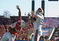 01 January 2007: Auburn tight end Tommy Trott (#5) and Nebraska defender Barry Turner (#99) look for the ball on a botched reception during the 2007 AT&T Cotton Bowl Classic between The University of Auburn and The University of Nebraska at The Cotton Bowl in Dallas, TX.