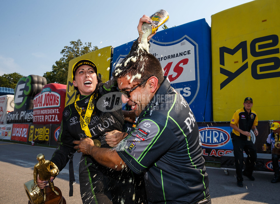 Aug 20, 2017; Brainerd, MN, USA; NHRA funny car driver Alexis DeJoria celebrates with a crewman after winning the Lucas Oil Nationals at Brainerd International Raceway. Mandatory Credit: Mark J. Rebilas-USA TODAY Sports