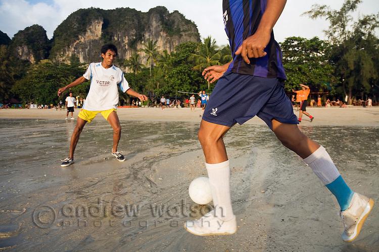 Locals play beach football on the sands of Hat Rai Leh West, Krabi province, THAILAND.