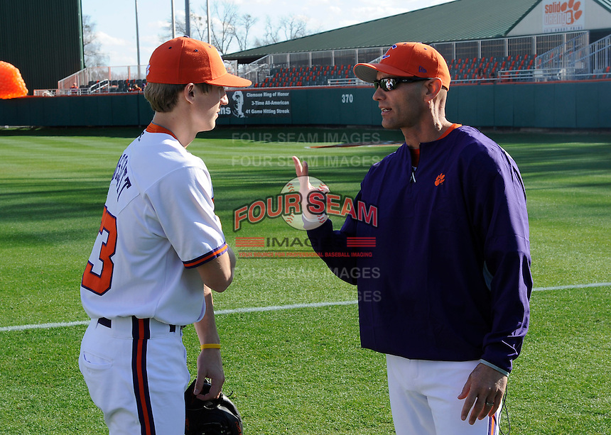 Starting pitcher Daniel Gossett (23) of the Clemson Tigers talks with pitching coach Dan Pepicelli before a game against the William & Mary Tribe on Opening Day, Friday, February 15, 2013, at Doug Kingsmore Stadium in Clemson, South Carolina. Clemson won, 2-0. (Tom Priddy/Four Seam Images)