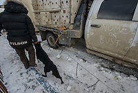 Billy Snodgrass unloads dogs before the ceremonial start of the 2016 Iditarod in downtown Anchorage. Photo by James R. Evans