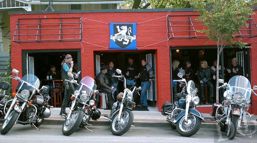 BROOKE McNEELY Northwest Arkansas Times<br /> Bikers hang out in the new Crown Pub Thursday on Dickson Street during the second day of Bikes , Blues and BBQ in Fayetteville.