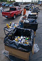 A hazardous waste worker sort through bottles and cans of leftover household chemicals and cleaners dropped off at a hazardous waste disposal site in Westerville, Ohio. Homeowners were able to remove any hazardous waste from their homes to be properly recycled or disposed of instead of placing in their trash or pouring down the drain.