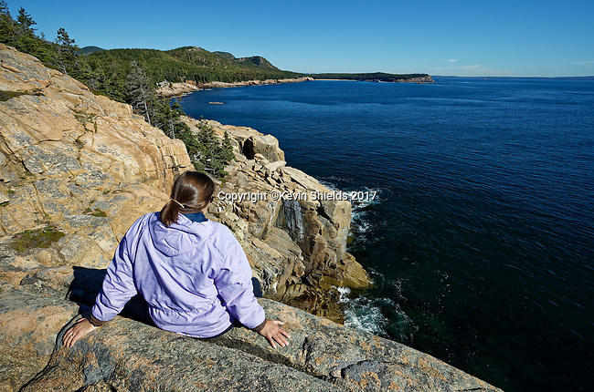 Woman on Otter Cliffs, Acadia National Park, Maine, USA