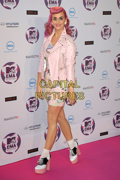 Katy Perry.MTV European Music Awards EMA red carpet arrivals, Odyssey Arena, Belfast, Northern Ireland..6th November 2011.full length pink leather jacket pastel sunglasses shades dress print socks white black platform trainers sneakers .CAP/PL.©Phil Loftus/Capital Pictures.