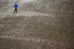 NEWPORT, WALES - OCTOBER 1: A general view of a fan walking through a flooded course during the 2010 Ryder Cup at the Celtic Manor Resort on October 1, 2010 in Newport, Wales. (Photo by Donald Miralle)