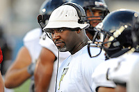 30 March 2012:  FIU Assistant Coach Apollo Wright speaks with players during the FIU Football Spring Game at University Park Stadium in Miami, Florida.