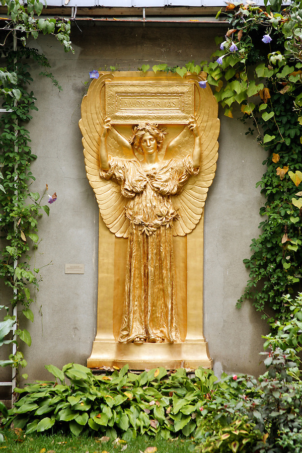 Golden relief of female angel in garden setting, New Gallery atrium, Saint-Gaudens National Historic Site, Cornish, Sullivan County, New Hampshire, USA