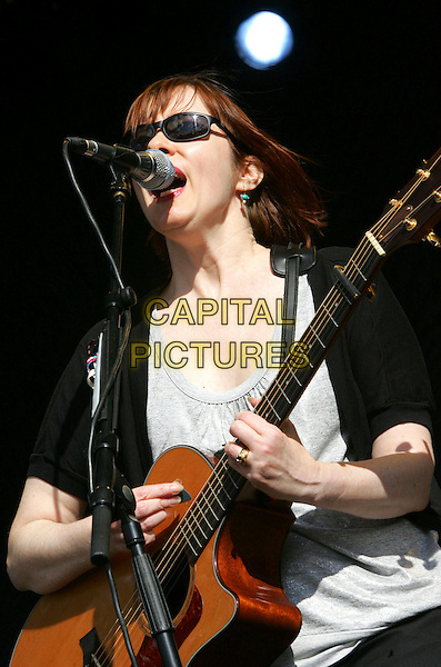 SUZANNE VEGA.Cornbury Music Festival, Oxford.7th & 8th June 2007, England.playing performing live in concert on stage gig guital half length.Ref: CAP/ROS.©Steve Ross/Capital Pictures