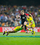 Australia play Canada in the Women's Rugby Sevens Cup Final on Day 1 of the Cathay Pacific / HSBC Hong Kong Sevens 2013 at Hong Kong Stadium, Hong Kong. Photo by Xaume Olleros / The Power of Sport Images