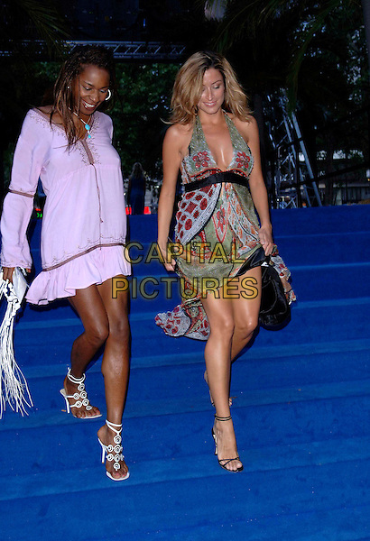 "SONIQUE & REBECCA LOOS.European film premiere""Miami Vice"".Odeon cinema Leicester Square.27th July 2006 in London, England.Ref: FIN.half length green pattern dress lifting legs lilac purple steps stairs.www.capitalpictures.com.sales@capitalpictures.com.©Steve Finn/Capital Pictures."