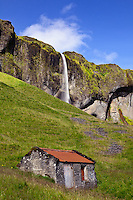 Stone barn and waterfall, Iceland