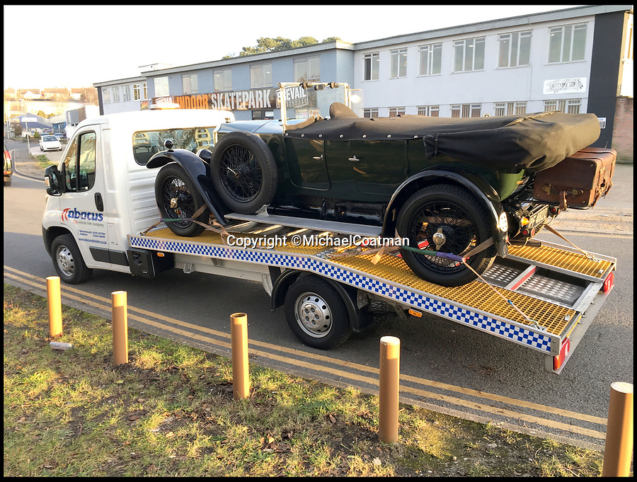 BNPS.co.uk (01202 558833)<br /> Pic:  MichaelCoatman/BNPS<br /> <br /> The vintage car pictured on the low-loader which the immigrants managed to climb on.<br /> <br /> A classic car enthusiast got the shock of his life when he found an illegal immigrant asleep inside his vintage motor when he arrived back in the UK.<br /> <br /> Michael Coatman, 64, was driving his vintage 1926 Vauxhall 14/40 open tourer back from a car show in Perigueux, France, when he was targeted by immigrants twice in a matter of hours.<br /> <br /> The semi-retired car salesman from Poole, Dorset, who was transporting the vintage car on a low-loader, discovered the first stow-away at a petrol station just before boarding the ferry in Caen.<br /> <br /> Despite Mr Coatman's vehicle being thoroughly searched at the port in Caen, when he got off in Portsmouth another search revealed a Somalian immigrant asleep in the front seat of his classic Vauxhall.
