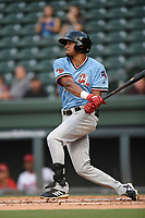 Center fielder Bubba Thompson (25) of the Hickory Crawdads follows through on a swing during a game against the Greenville Drive on Monday, August 20, 2018, at Fluor Field at the West End in Greenville, South Carolina. Hickory won, 11-2. (Tom Priddy/Four Seam Images)