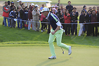 Marcel Siem (GER) sinks his putt on the 16th green from the crowd during Sunday's Final Round of the 2014 BMW Masters held at Lake Malaren, Shanghai, China. 2nd November 2014.<br /> Picture: Eoin Clarke www.golffile.ie