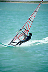 Windsurfing is a surface water sport that combines elements of surfing and sailing.<br /> (3)