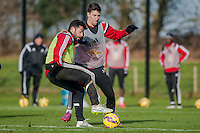 SWANSEA, WALES - JANUARY 28:  Jordi Amat of Swansea City and Federico Fernández of Swansea City go for the ball during training  on January 28, 2015 in Swansea, Wales.