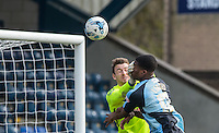 Goalkeeper Jamie Jones of Stevenage gives Rowan Liburd of Wycombe Wanderers a facefull of glove during an attack  during the Sky Bet League 2 match between Wycombe Wanderers and Stevenage at Adams Park, High Wycombe, England on 12 March 2016. Photo by Andy Rowland/PRiME Media Images.
