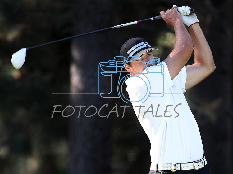 Oakland Raiders quarterback Kyle Boller watches his shot during a practice round at the 22nd American Century Celebrity Golf Championship at Edgewood Tahoe Golf Course in Stateline, Nev., on Thursday, July 14, 2011. .Photo by Cathleen Allison