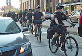 Police officers on bicycles ride down Euclid Avenue about two blocks from the Quicken Loans Arena, site of the 2016 Republican National Convention in Cleveland, Ohio on Saturday, July 16, 2016.<br /> Credit: Ron Sachs / CNP<br /> (RESTRICTION: NO New York or New Jersey Newspapers or newspapers within a 75 mile radius of New York City)