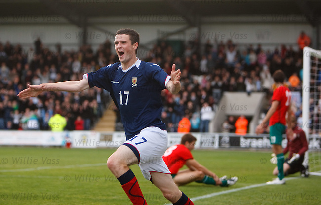 Jamie Murphy scores a last gasp winner for Scotland and celebrates his goal