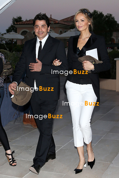 """ADRIANA KAREMBEU & ANDRE OHANIAN- June 12, 2013-53rd Monte-Carlo TV Festival. Adriana Karembeu and Andre Ohanian attend the '"""" Dallas' """" Party at the Monte-Carlo Bay hotel."""