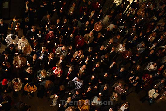 Salt Lake City - Salt Lake City Mayor Rocky Anderson addresses a large crowd at a candlelight memorial in the Salt Lake City Library to remember the victims of the Trolley Square shooting. Lining the staircase around Anderson were the police officers who responded to the scene, Utah Governor Jon Huntsman, Bosnian Ambassador Bisera Turkovic, Salt Lake County Mayor Pete Corroon, and family members of victim Kirsten Hinckley.