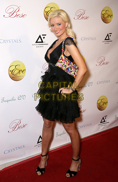 HOLLY MADISON.Holly Madison Hosts Adriana Fernandez US Bikini Launch and Fashion Show at Eve Nightclub inside Crystals at CityCenter, Las Vegas, Nevada, USA..March 5th, 2010.full length black dress cleavage low cut neckline lace sheer layers layered hand on hip handbag multicoloured .CAP/ADM//MJT.© MJT/AdMedia/Capital Pictures.