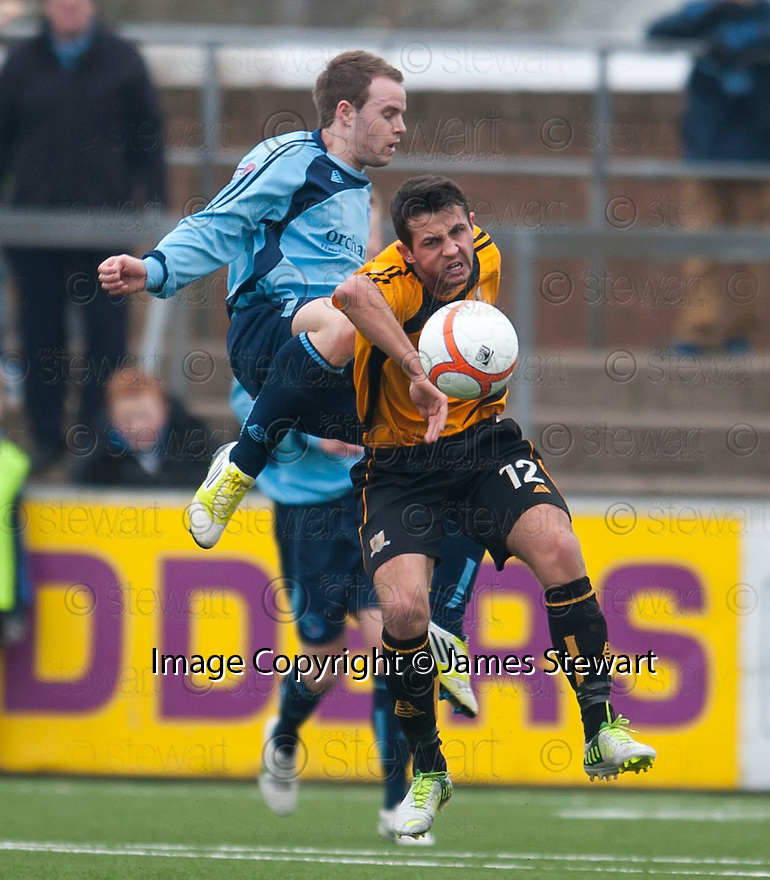 Alloa's Gavin Stokes is caught late by Forfar's Gavin Malin.
