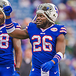 """14 December 2014: Buffalo Bills running back Anthony """"Boobie"""" Dixon (26), concludes his pre-game warm ups prior to facing the Green Bay Packers at Ralph Wilson Stadium in Orchard Park, NY. The Bills defeated the Packers 21-13, snapping the Packers' 5-game winning streak and keeping the Bills' 2014 playoff hopes alive. Mandatory Credit: Ed Wolfstein Photo *** RAW (NEF) Image File Available ***"""