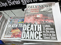 Front pages on Sunday, December 4, 2016 of the New York Daily News and New York Post report on the previous day's fire in a warehouse, allegedly used as artists' residences, during a dance party. Nine people are confirmed dead with up to 25 missing.  (© Richard B. Levine)