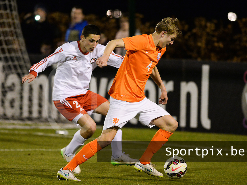 20150312 - SCHIJNDEL , NETHERLANDS  : Dutch Jelle De Lange (right) pictured before defending Georgian Giorgi Berdzenadze (left)  during the soccer match between Under 17 teams of The Netherlands and Georgia  , on the first matchday in group 3 of the UEFA Elite Round Under 17 at Sportpark Zuideinderpark , Schijndel , The Netherlands . Thursday  12 th March 2015 . PHOTO DAVID CATRY
