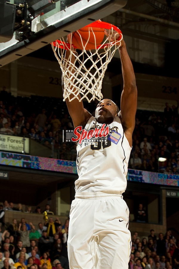 Travis McKie (30) of the Wake Forest Demon Deacons goes up for a slam dunk during second half action against the Duke Blue Devils at the LJVM Coliseum on January 30, 2013 in Winston-Salem, North Carolina.  The Blue Devils defeated the Demon Deacons 75-70.  (Brian Westerholt/Sports On Film)