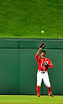 23 April 2010: Washington Nationals' outfielder Nyjer Morgan pulls in a 5th inning fly ball during a game against the Los Angeles Dodgers at Nationals Park in Washington, DC. The Nationals defeated the Dodgers 5-1 in the first game of their 3-game series. Mandatory Credit: Ed Wolfstein Photo