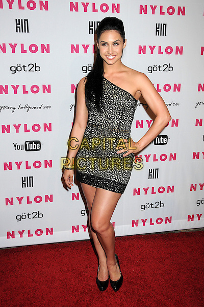 LAUREN GOTTLIEB.Nylon Magazine's Young Hollywood Party held at the Roosevelt Hotel's Tropicana Bar, Hollywood, California, USA..May 12th, 2010.full length black lace one shoulder dress hand on hip shoes.CAP/ADM/BP.©Byron Purvis/AdMedia/Capital Pictures.