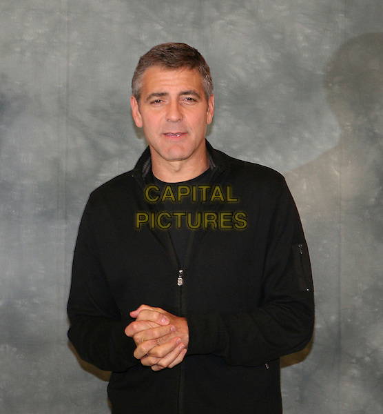 "GEORGE CLOONEY .Photocall for film ""Leatherheads"" ( Italian - 'In amore niente regole"" ).in Rome, Italy, April 10th 2008..half length black top zip-up jumper hands together .CAP/CAV.©Luca Cavalari/Capital Pictures"