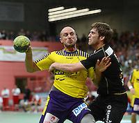 Handball 1. Bundesliga  2012/2013  in der Paul Horn Arena Tuebingen TV Neuhausen - Fuechse Berlin Jonas Thuemmler (li, Fuechse Berlin) gegen Klaus Schuldt (TV Neuhausen)