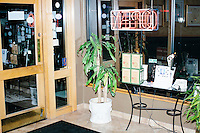 "A plant stands in the entryway of the restaurant after Harvard Law professor and Democratic presidential candidate Lawrence Lessig spoke at a meeting of the Salem Democrats at The Colosseum Restaurant in Salem, NH. This campaign event was Lessig's first visit to New Hampshire, though he had not yet raised the $1 million he wanted to raise before officially declaring his candidacy. The following week, Lessig raised the money and declared his candidacy. Lessig is running an unusual campaign, calling himself a ""referendum candidate."" He has said his campaign will focus on a single issue, The Citizen Equality Act, which would reform campaign financing, gerrymandering, and access to voting. Lessig has pledged that, if elected, once the Citizen Equality Act becomes law, he will immediately resign and turn the presidency over to his vice president."
