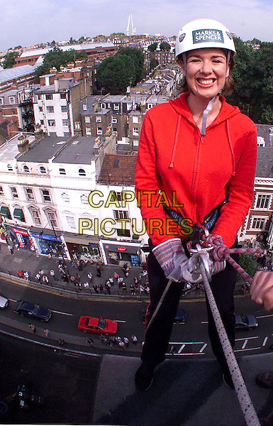 "CLAIRE SWEENEY.abseils down Marks & Spencer shop, Kensington High Street, to launch new range of cleavage enhancing bra ""Ego Boost"", London, 1st August 2001..half length.Ref: PL.www.capitalpictures.com.sales@capitalpictures.com.©Capital Pictures."