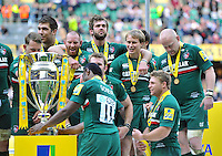 Leicester Tigers players inspect the Aviva Premiership trophy. Aviva Premiership Final, between Leicester Tigers and Northampton Saints on May 25, 2013 at Twickenham Stadium in London, England. Photo by: Patrick Khachfe / Onside Images