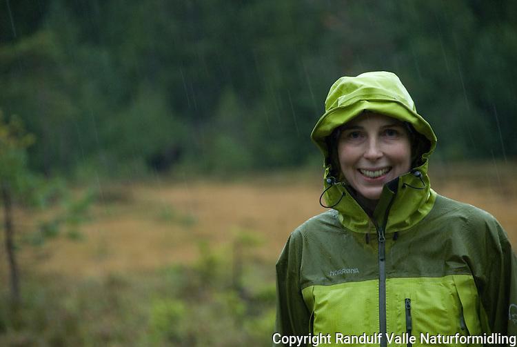Jente i skog i regn ---- Girl in forest in rain