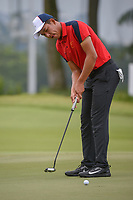 Cheng JIN (CHN) watches his putt on 11 during Rd 4 of the Asia-Pacific Amateur Championship, Sentosa Golf Club, Singapore. 10/7/2018.<br /> Picture: Golffile | Ken Murray<br /> <br /> <br /> All photo usage must carry mandatory copyright credit (&copy; Golffile | Ken Murray)